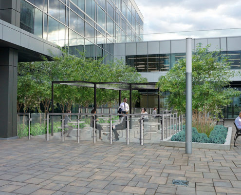 Rendering of the outdoor amenity space with a railing surrounding the outside seating area and planters on either sides