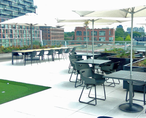 Seating area on a rooftop patio with a complete with a mini putt green