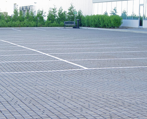 Permeable paving in a parking lot at 2475 Hogan Drive