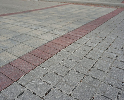 A close up shot of permeable paving showing the spaces between the stones