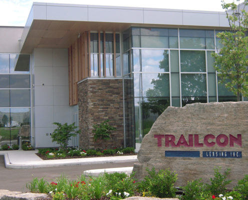 Trailcon signage in front of their office with surrounding flower beds designed by Brodie and Associates