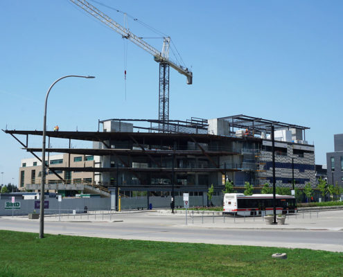 Humber College Barrett Centre being constructed. Median with garden in front of building