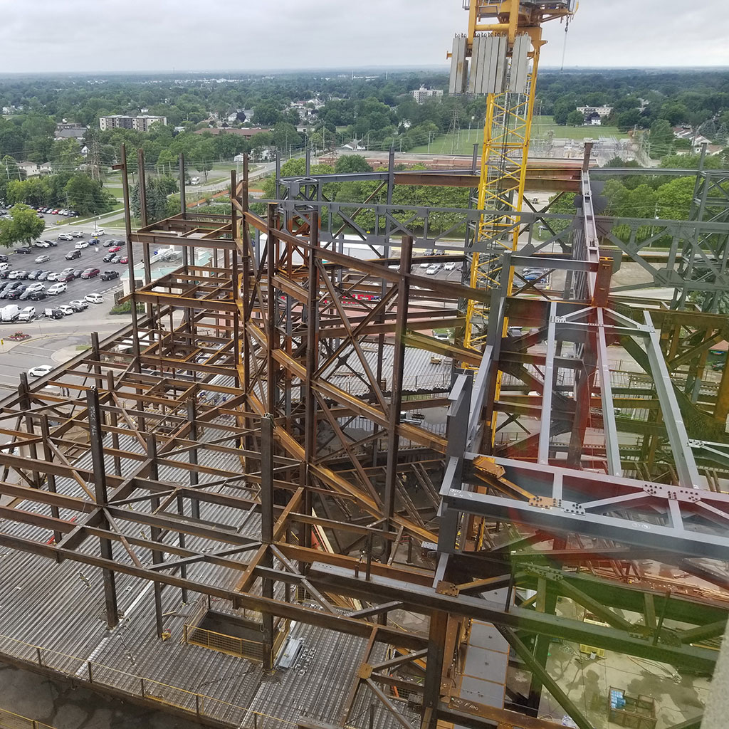 Steel skeleton of the Niagara Falls Entertainment Centre being constructed with a yellow crane in the center