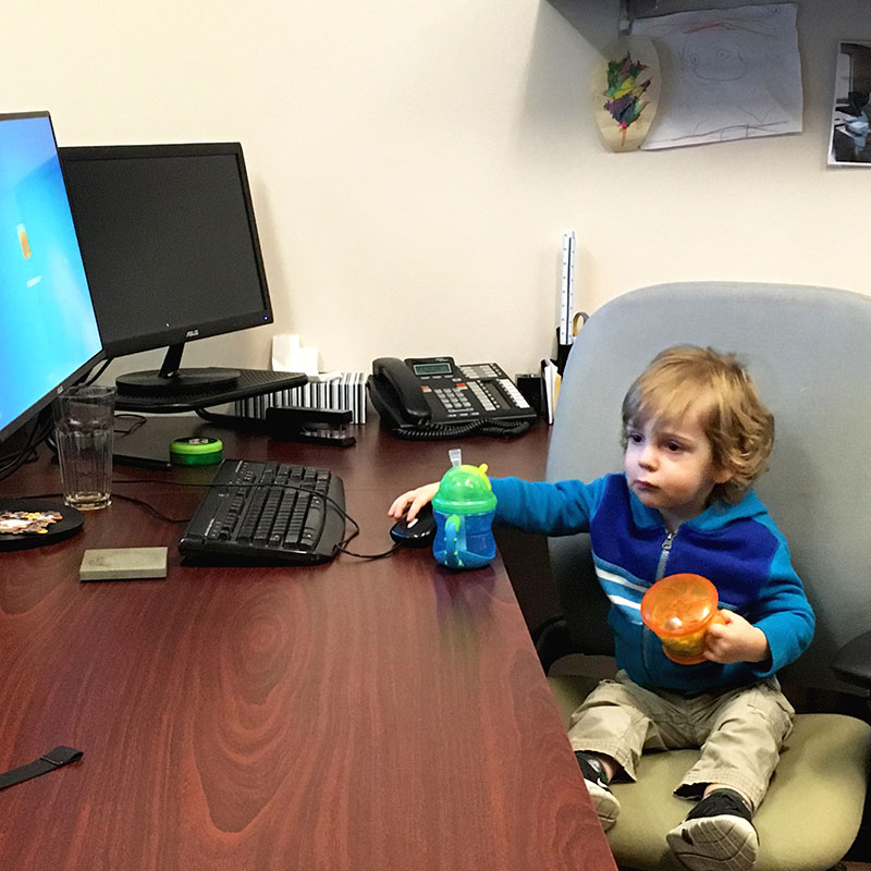 Child working at desk with snacks