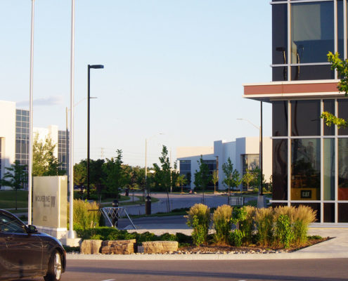 Armour stone and ornamental grasses at entrance to Wolverine Canada Offices