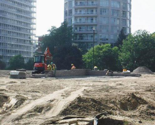 Construction workers pay stone for the redesigned gardens in Sir Winston Churchill park