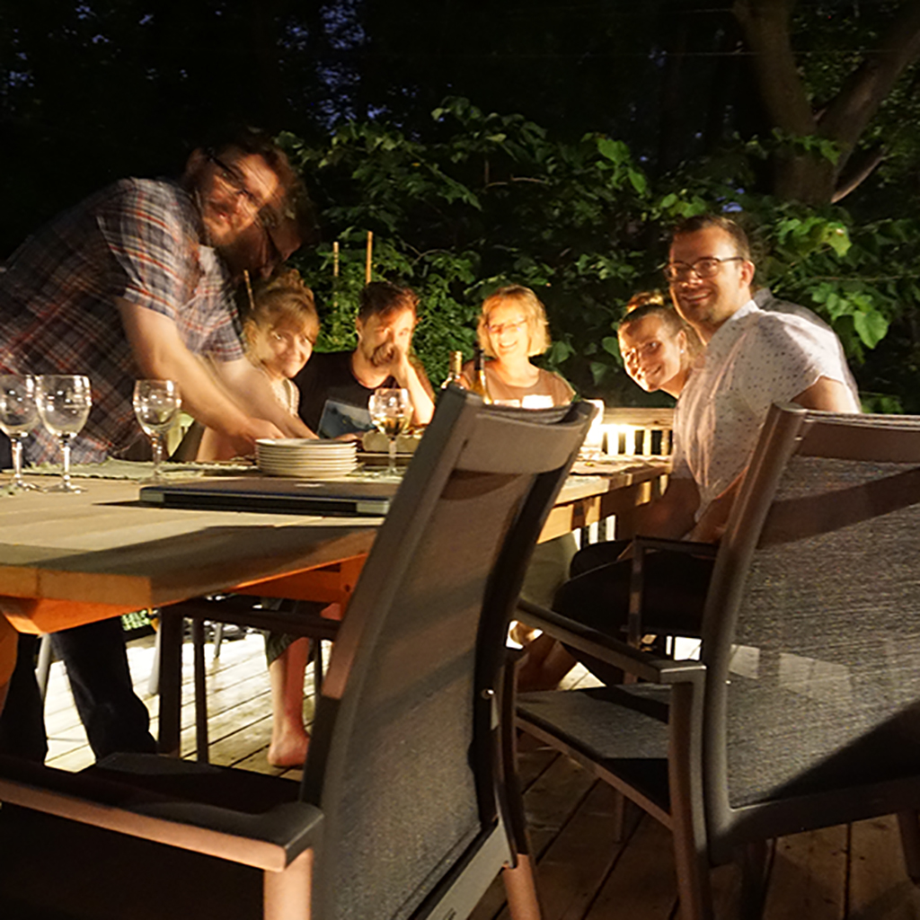 Nate, Carleigh, Thomas, Helle, Sarah and Ryan gathered around the table in Helle's backyard